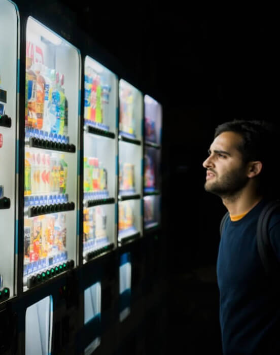 Man looking at vending machine