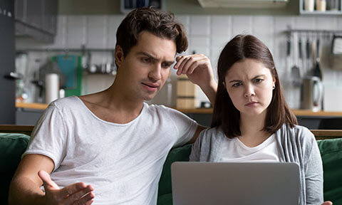 People looking at computer confused