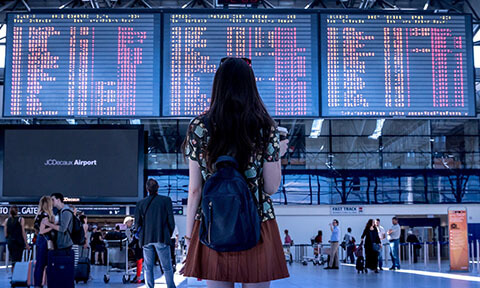 person looking and flights screen