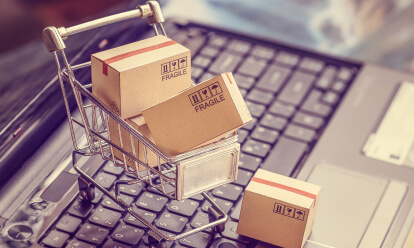 shopping cart of boxes with computer